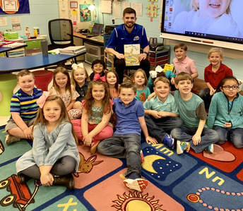 UAH Basketball students read to CCPS students