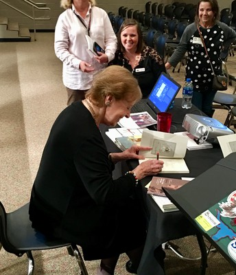 Mrs. Lazan enjoying time autographing books