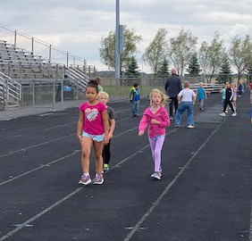 Walk as many laps as you can to raise money for our school!