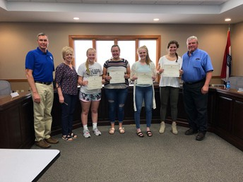 HHS FCCLA students are congratulated by Directors Stiers & Englert