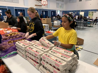 Students and Parents Helping with 2nd Harvest Food Distribution