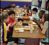 Fifth Graders Enjoying Lunch