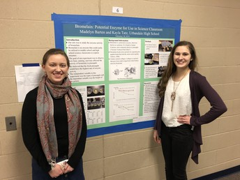 AP College Biology students display research in poster fair.