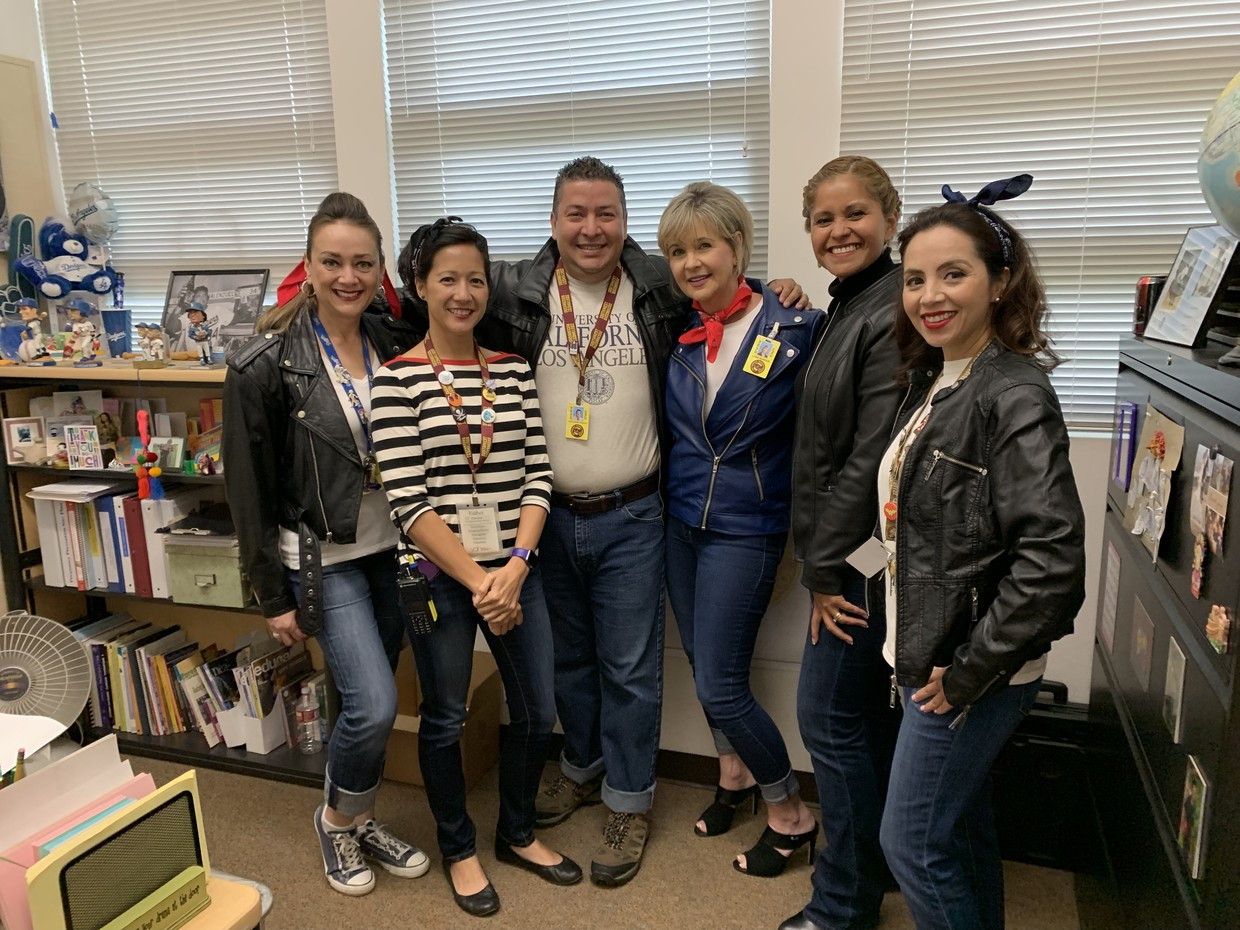 Admin and counselors don leather jackets, chucks, and smiles, as they pose with ASB coordinator, Ms. Parrenas, clad in an Audrey Hepburn mod aesthetic.