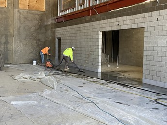 The cement block in cafe getting scrubbed!