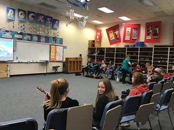 Students have a chance to practice the ukulele.