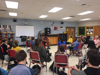 Seth Parker Woods performing for the 7th grade orchestra