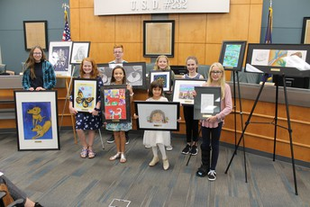 USD 232 Recognizes student artist and the Admin Office