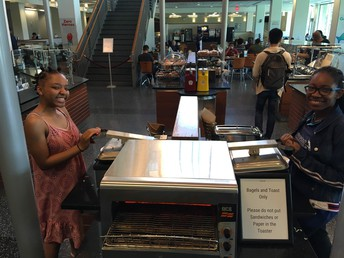 Te'Nia and Angel on the sandwich press at U of M