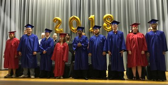 OSSB 2018 graduates shown on OSSB stage with gold balloons  behind them that read 2018. Left to right, Lalita, Cameron, Alex C., Lee Ann, Awat, Sam, Alex S., Jodie and Byron.