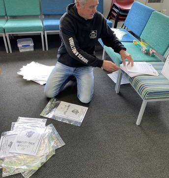 Mr G sorting 'Hard learning packs'