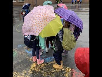 The umbrella huddle!