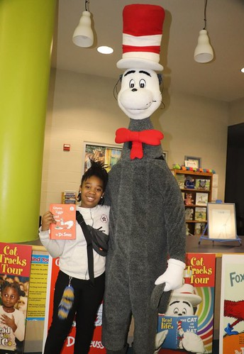 A student poses with Cat in the Hat