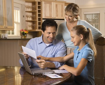Parents reviewing homework with student