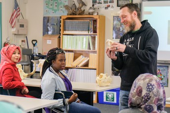 Mr. Hanson helps students identify skulls in Zoology
