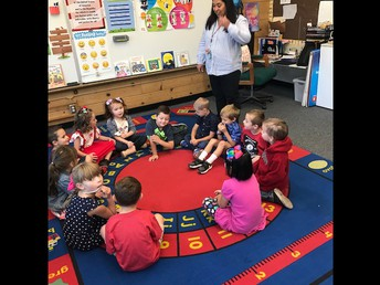 Ms. Twitchell starting the day with our K students!