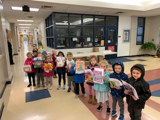 Mrs. Savage's 4-year olds leave library class with new books.