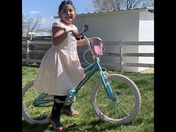 Gianna out get fresh air and exercise on her cool bike.