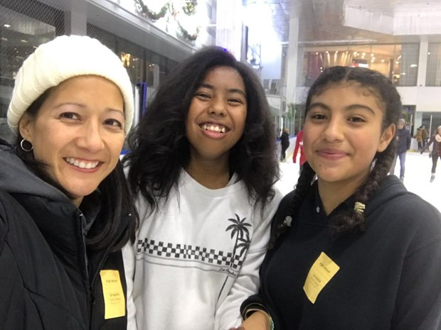 Ms. Parrenas all smiles with ASB students during their annual ice skating fieldtrip.