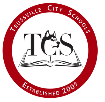 Circular Trussville City Schools logo with drawing of an open book an TCS with line drawing of a husky dog head