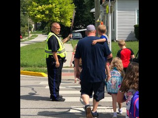 Thank you SRO Dixon for helping our students cross the street safely!