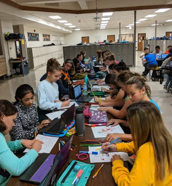 7th grade working on a School-wide Project