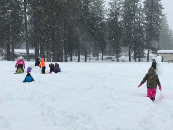 CES students wading through snow on Monday