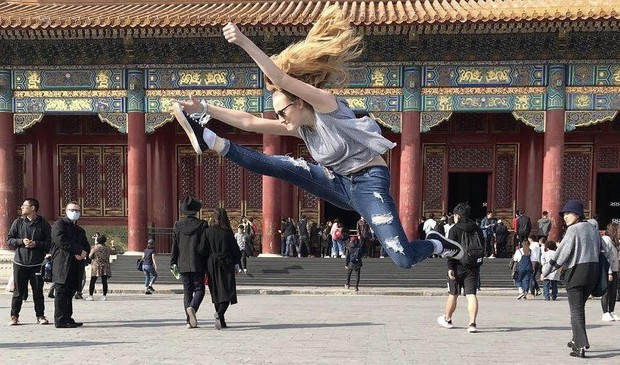 QCHS student jumps for joy during China trip.
