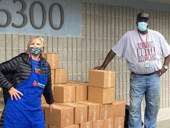 Ms. Susan and Mr. Don helping with food distribution!