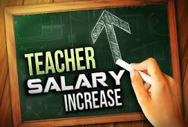 Teacher Salary Increase being written on a chalkboard