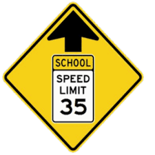 CAUTION: Speed limit is 35mph in front of the school on county road 23