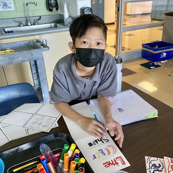 A student works on their art assignment