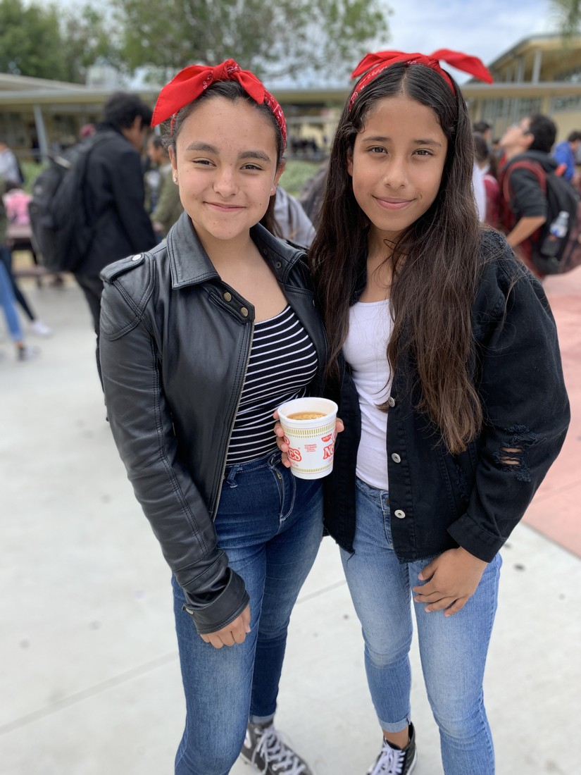 Students showing pride at lunch during 50s/60's spirit day, dressed in red bandanas, leather jackets, jeans and chucks.