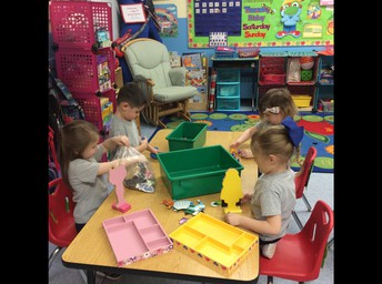PreK 3 students love working together during center time.