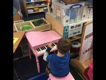 Student playing piano!