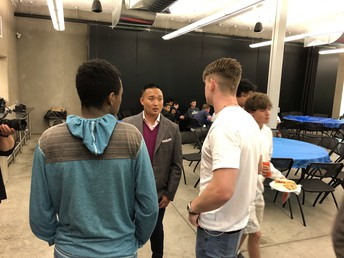 Zach talks with seniors following his talk