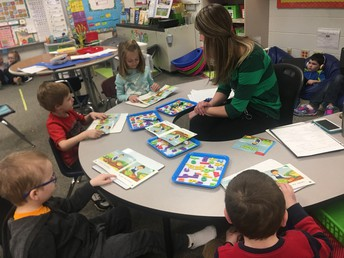 Cheryl leading students in a level A book.