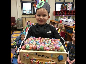 """Kindergarten student Dexter Clarke decorated a wooden box and filled it with 100 lollipops to demonstrate his """"counting to 100"""" proficiency, as well as his creativity."""
