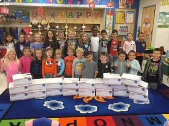 Kindergarten Students Prepare Packages for Troops