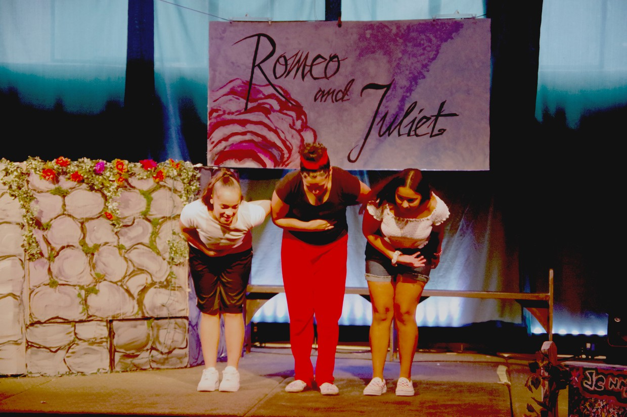 Romeo and Juliet student performers taking a bow