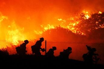 Firefighters battle a large fire
