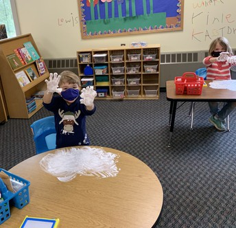 CCS kindergarteners making letters in shaving cream