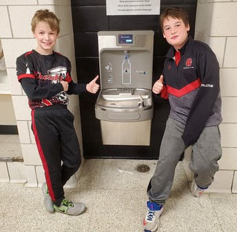 Chardon Middle School students give the thumbs up to water fountains funded by the school's PTO.