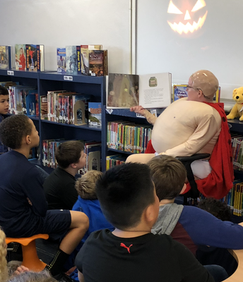 Captain Underpants reads to 3rd graders