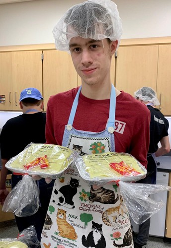 ASPIRE students prepare meals for the needy