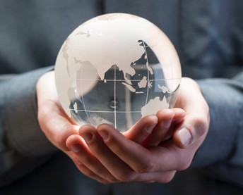 hand holding globe photo