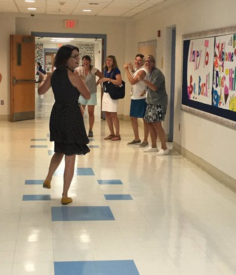 Principal Sullivan and Staff Dancing in the Halls...Happy for the Students' Return!