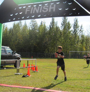Theo dashes over the finish line!