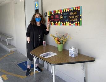 Mrs. Beigi's Welcome/Sanitation Table