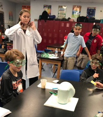 Faith Morano creating concoctions in science class